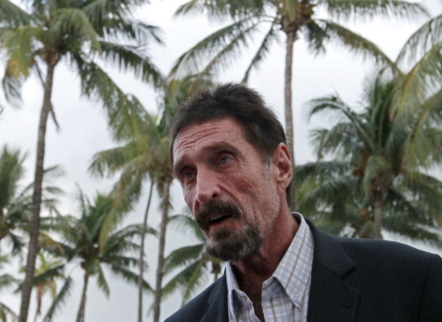 McAfee says will not return to Belize, willing to talk to police