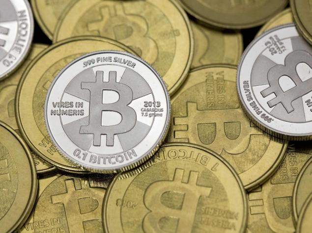 Mt. Gox Bitcoin exchange website goes offline as currency value plummets