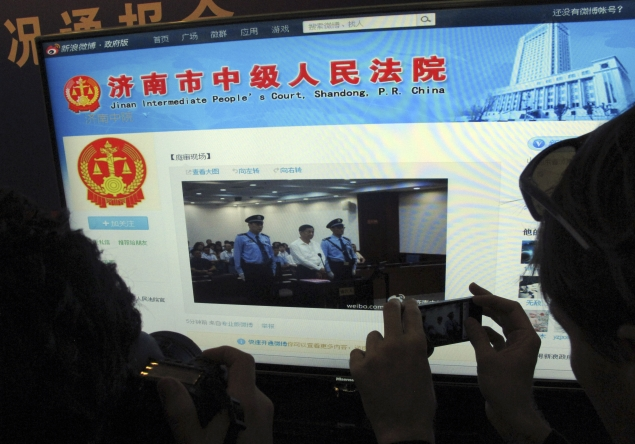 In rare openness, China microblogs disgraced politician's trial
