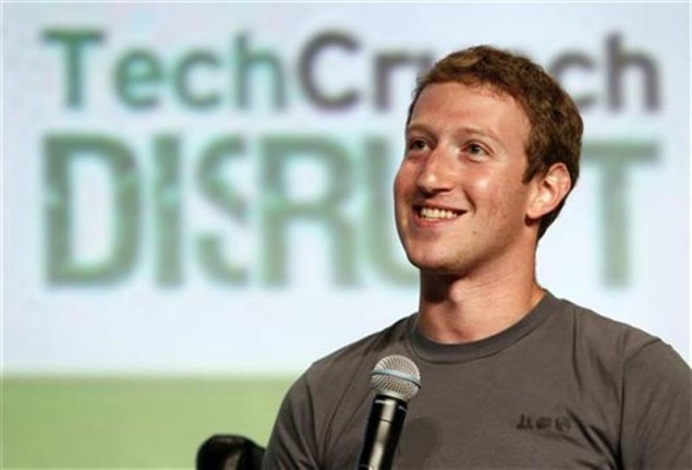 Facebook CEO dangles search and mobile, shares rally