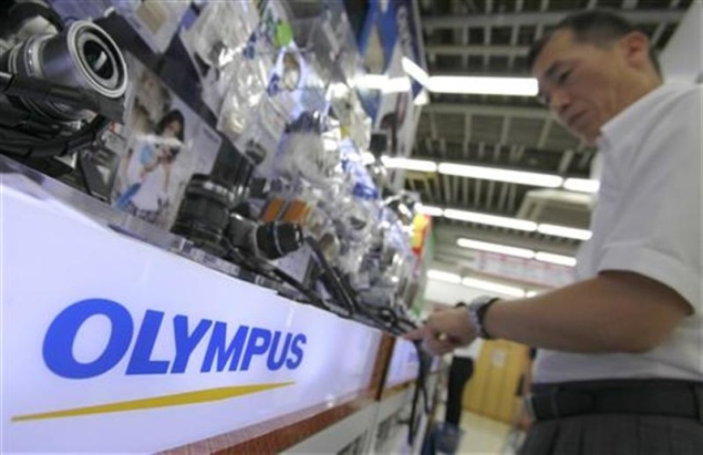 Olympus sells mobile telecom unit to fund for $676 million