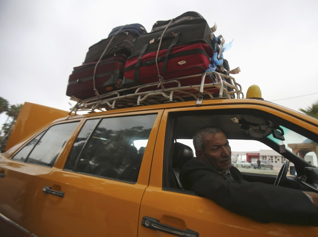 overloaded_taxi_reuters.jpg