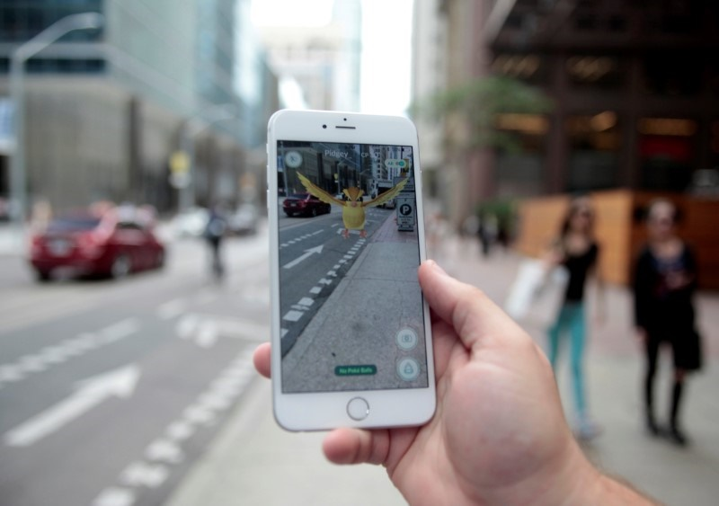 Pokemon Go Players Walk Dogs as They Hunt Digital Monsters