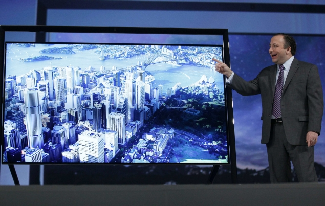 Samsung, LG unveil super-thin, curved OLED TVs
