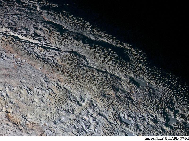 Nasa's Latest Pluto Photos Reveal Snakeskin-Like Surface Features
