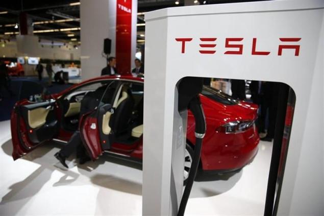 Tesla CEO Elon Musk confirms Apple talks, says deal 'unlikely': Report