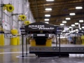 Amazon testing delivery packages using drones, CEO Bezos says