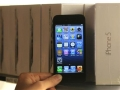 Apple reports strong iPhone sales but profit falls