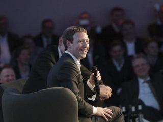 Germans Talk Tough, Fete Facebook's Zuckerberg