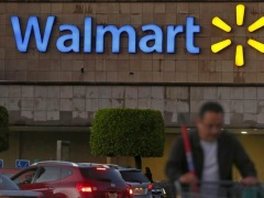 Walmart Trims Earnings Forecast To Include Impact From Flipkart Deal