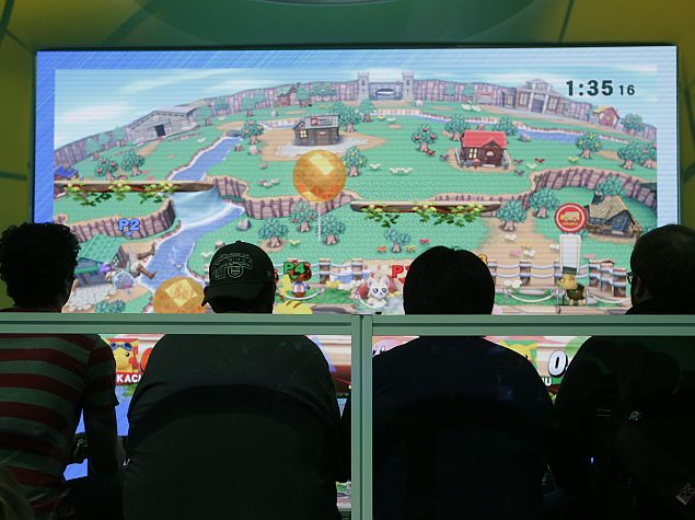 people_playing_super_mario_smash_bros_e3_2014_ap.jpg