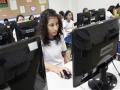 Online college classes, once aimed at advanced students, target the masses